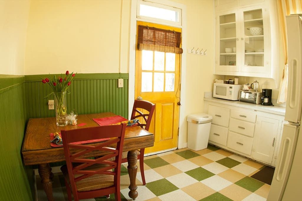 Kitchen entrance with an antique table.