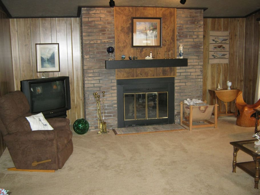 Large living room with wood burning fireplace