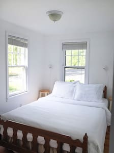 Queen bedroom with blackout blinds, new memory foam mattress and domestically produced (USA made) linens and towels.