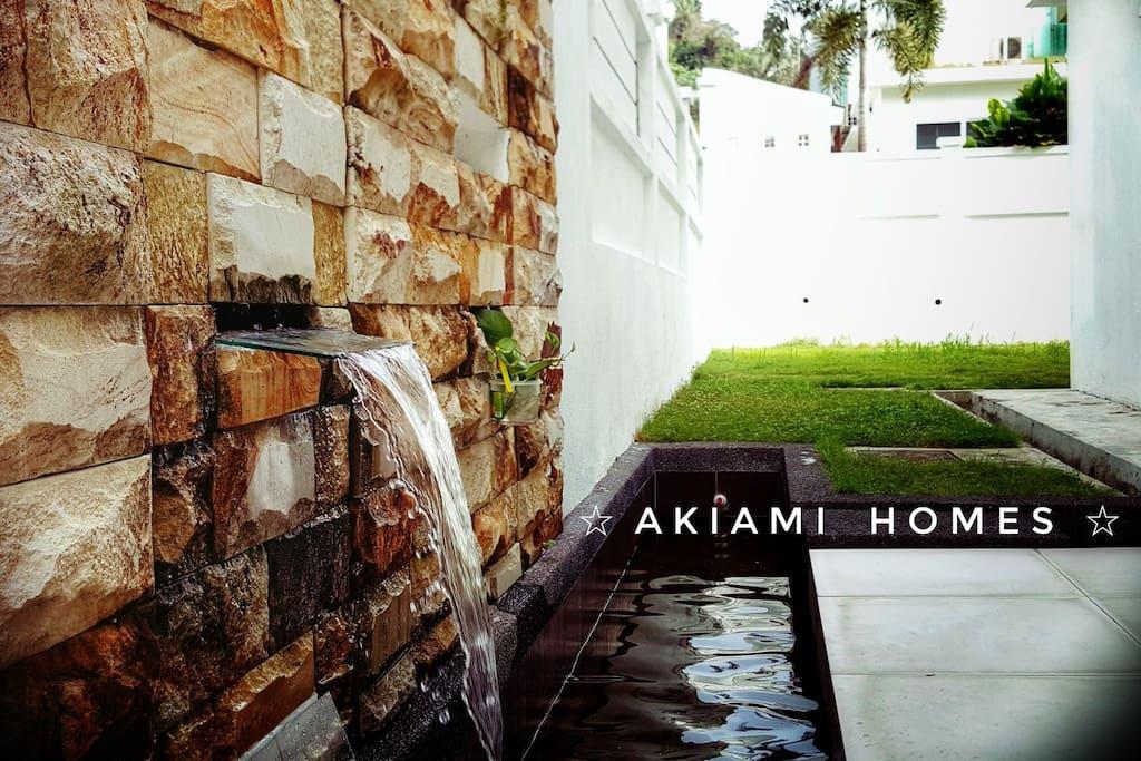 Side yard patio with beautiful water fountain