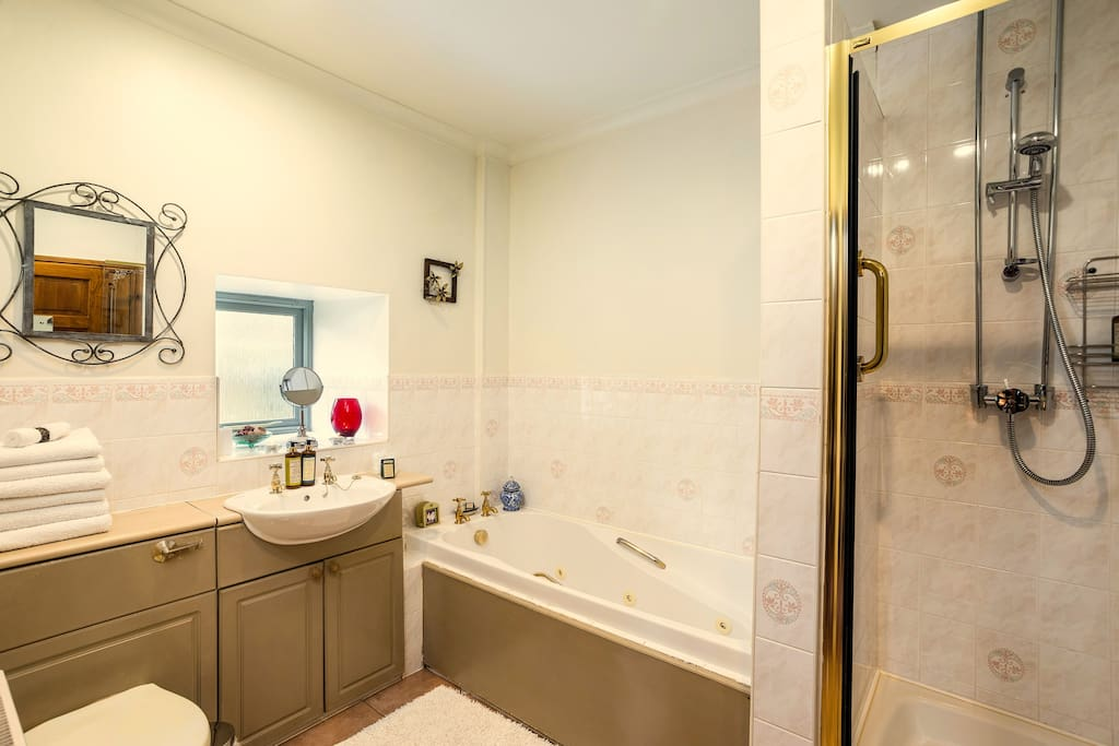 Bathroom with jacuzzi bath and walk in shower