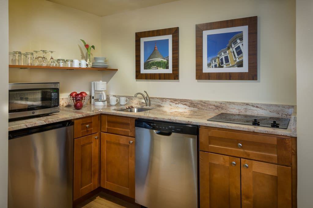 Newly renovated kitchenette has refrigerator, dishwasher and cook top.