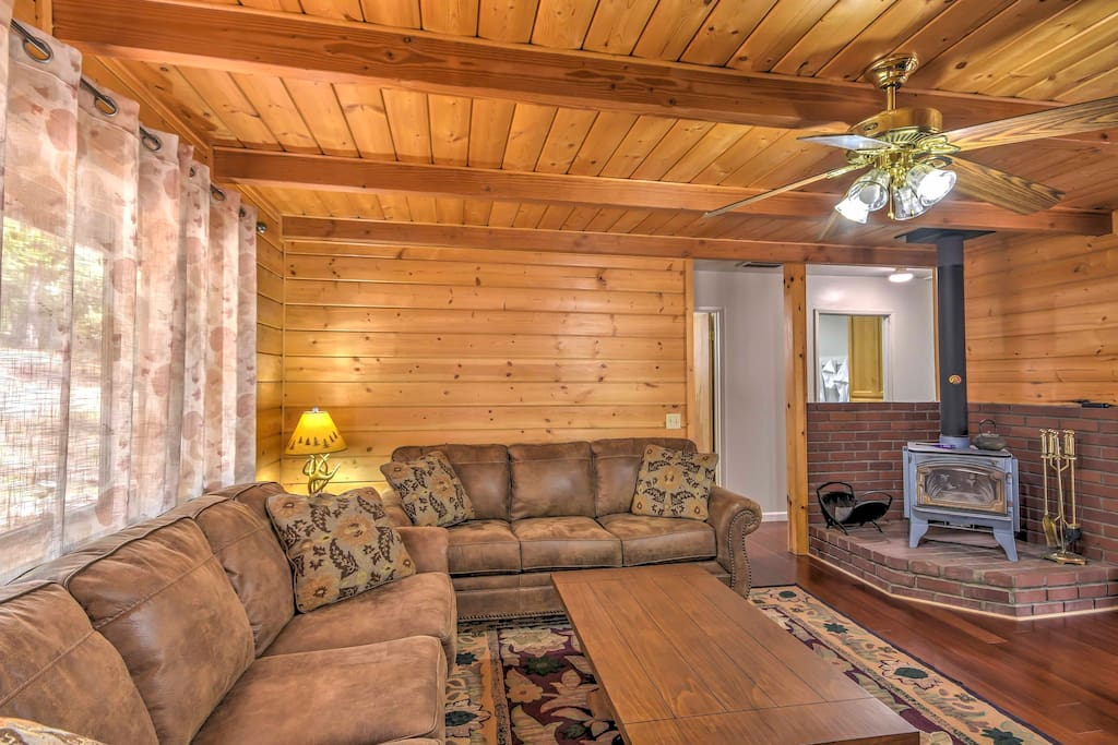Relax on one of the plush couches while warming up next to the wood-burning stove.