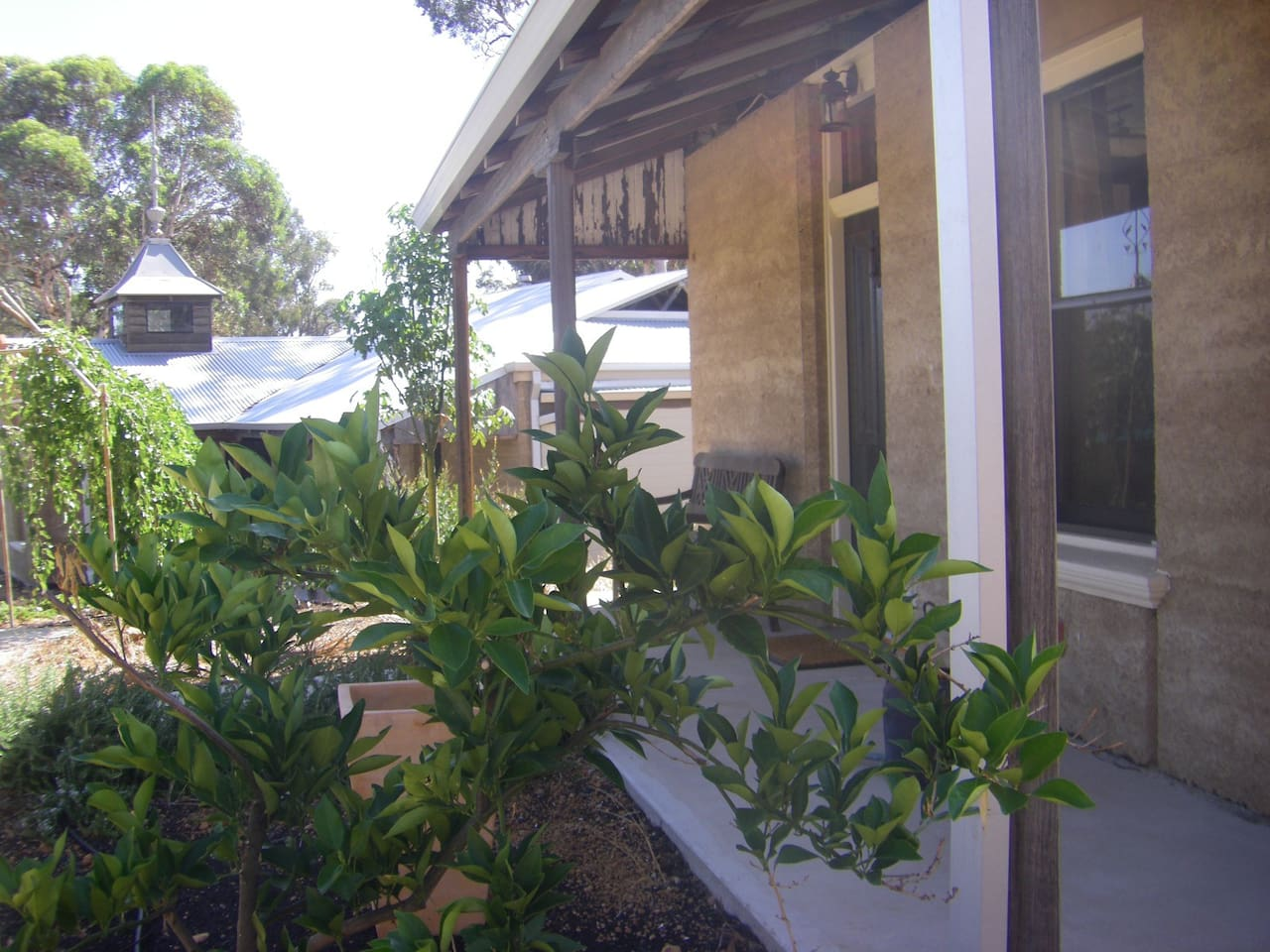 The rammed earth cottage and front veranda