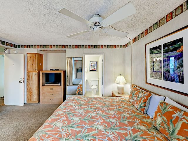 2nd bedroom with king-sized bed and window A/C unit
