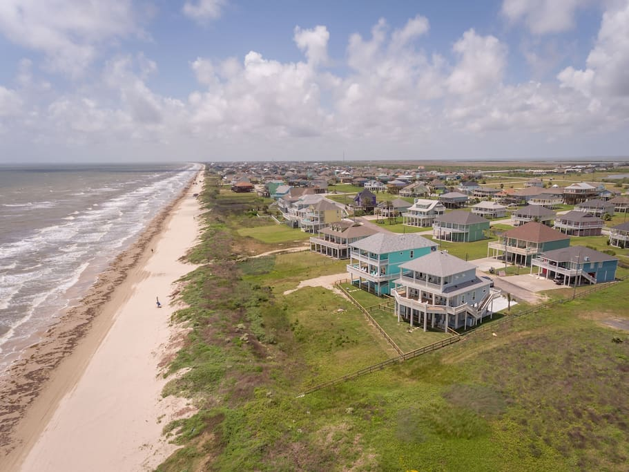 """We have both houses shown closest in this picture.  Both custom homes are beachfront with beach access just a few yards away. Both houses sit in a dead-end street which is very quiet! The house next door is named """"Sea it All"""".  Dolce Vida is the big turquoise house."""