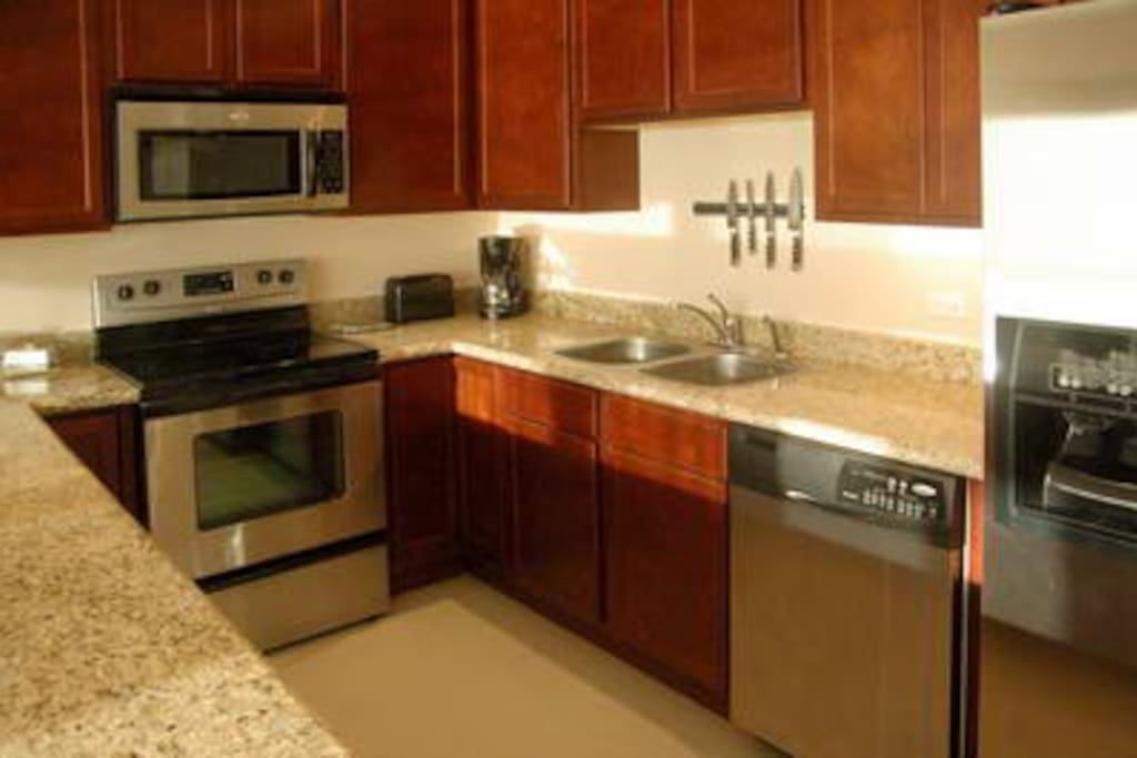 beautiful well equipped kitchen makes cooking at home a joy