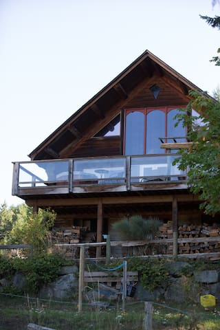 Front of log home with large deck