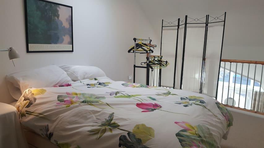 separate bedroom, at mezzanine level