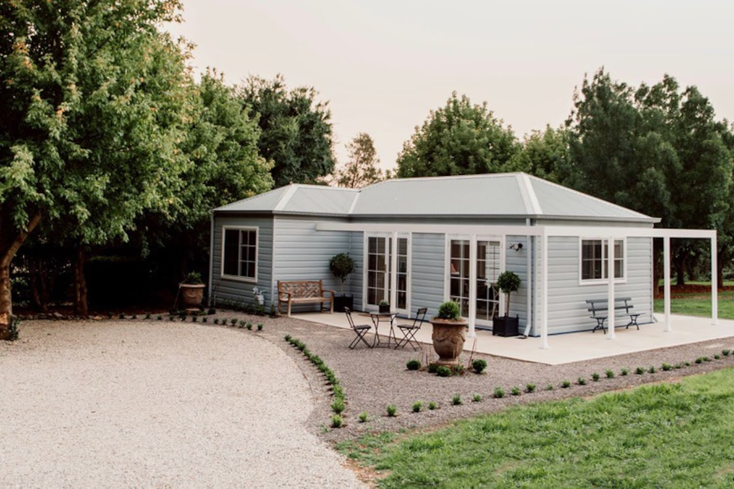 Entire private cosy cottage sun drenched and nestled into the surrounding mature trees