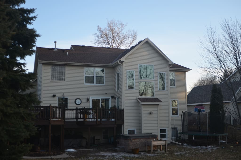 Rear of Home with Hot Tub, Trampoline and Lower Patio