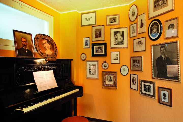 A music corner with the ancient piano. On the wall a genealogical tree of the  family