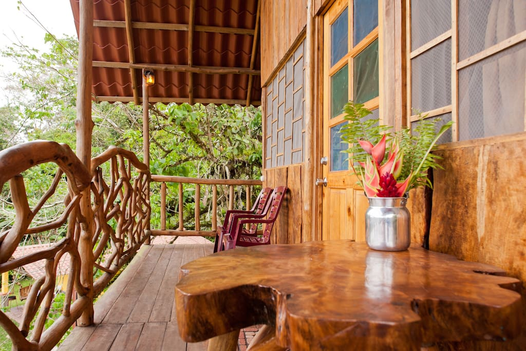 Table and chairs on the balcony that surrounds the Tree House