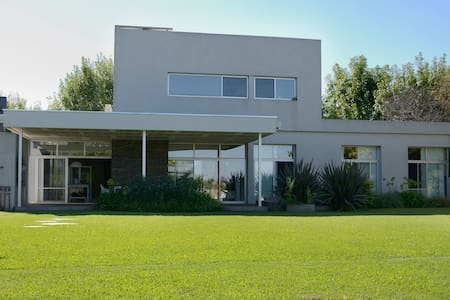 Modern house on lagoon in Tigre