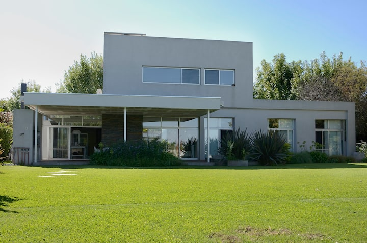 Modern house on lagoon in Tigre