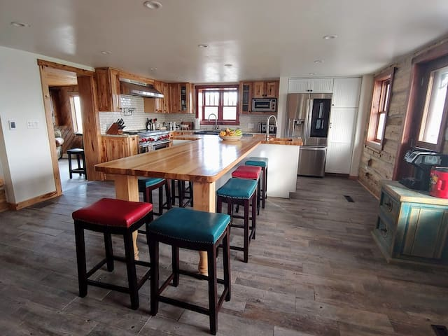 Our newly remodeled kitchen features the original logs from the homestead built in 1875! The table can easily seat 7 individuals with additional seating available.