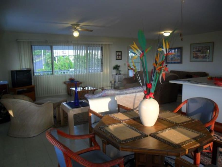 Dining room area of Great Room with the glow of sunset lighting.the area