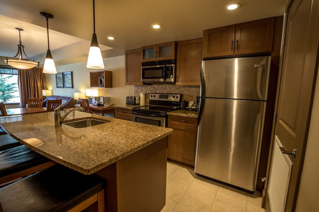 Enjoy the large kitchen with stainless steel appliances and huge breakfast bar