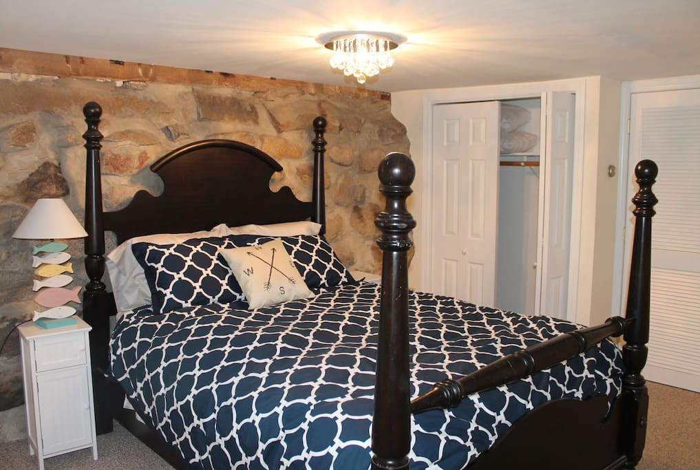 Queen Bed, gorgeous rock wall helps keep it cool and a perfect spot for an afternoon nap!