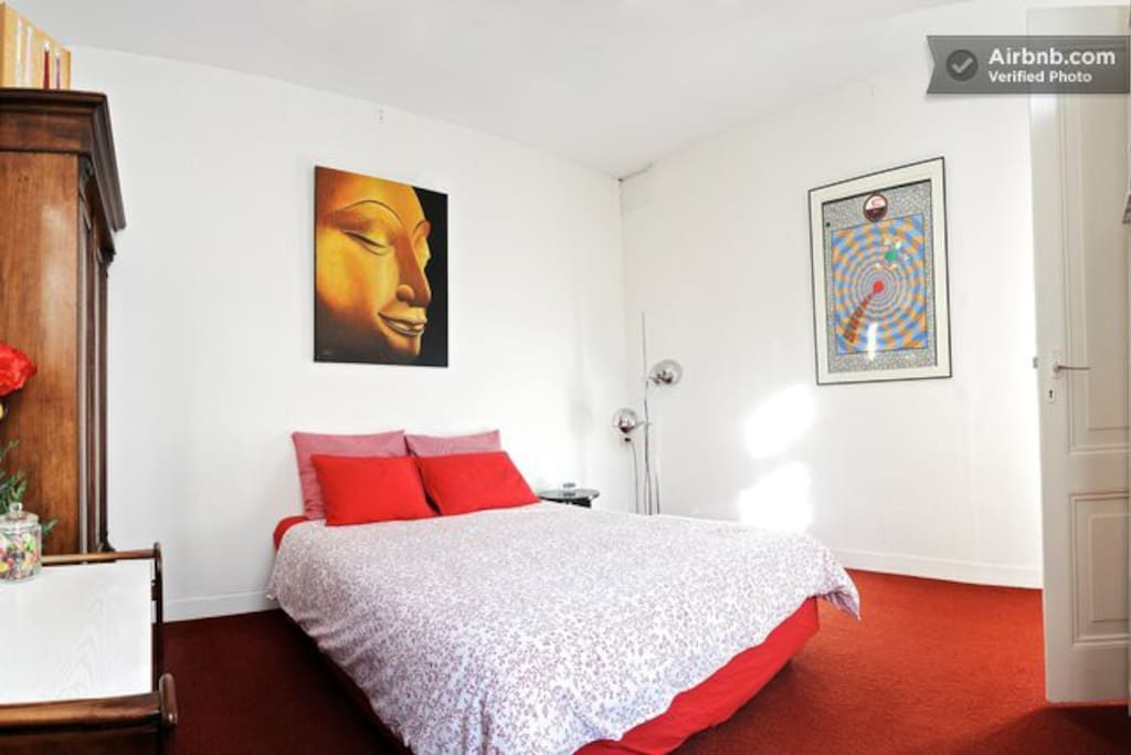 A comfortable bed and inspiring art