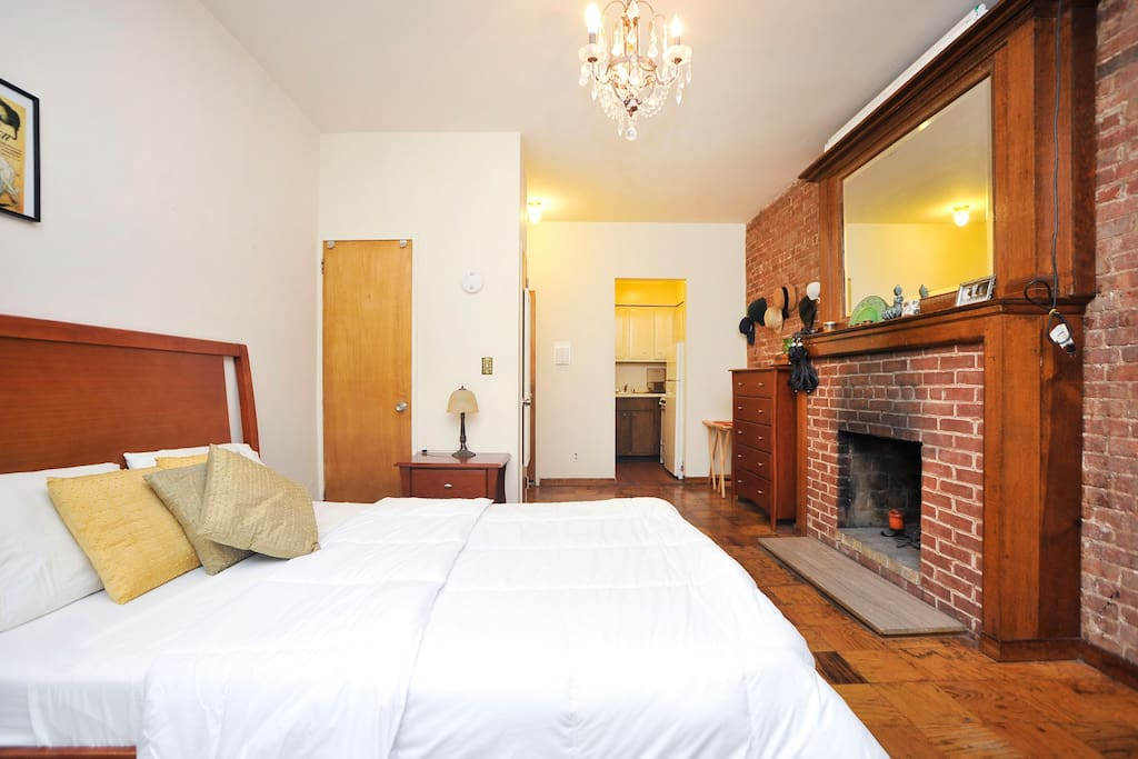 Exposed brick and a fire place (authentic brownstone apartment)
