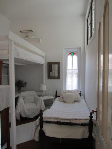 The cozy loft bedroom sleeps 3