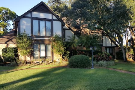 Beautiful four-bedroom and five bath, pool  home located on the number on the 14th tee box of private Feather Sound Country Club. Centrally located  with only a 20 minutes drive to the beaches, downtown St. Petersburg, and downtown Tampa/Ybor City.