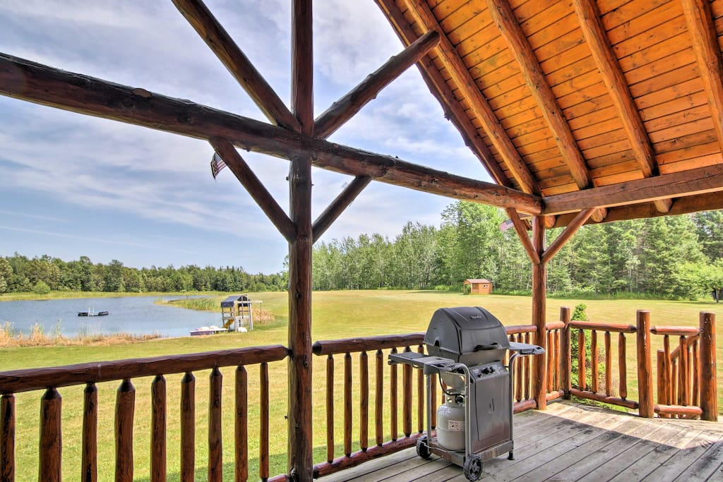 Enjoy scenic views of the 2-acre pond from the covered back deck.