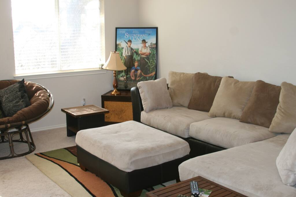 Private upstairs living area with plenty of seating and large flat screen TV and blu-ray player