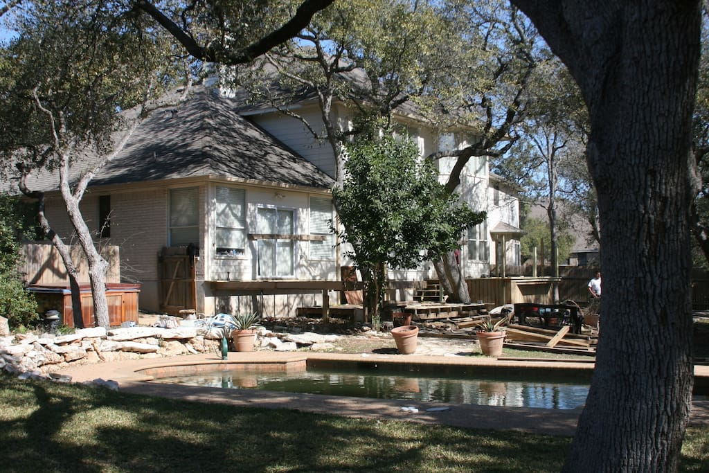 Bigger picture of huge backyard with swimming pool, hot tub and new deck under construction