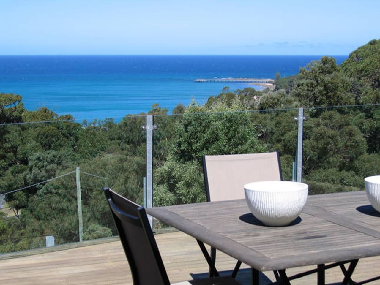 The 60 square metre deck stands 7 metres high giving a comanding view over the treetops to the bay.