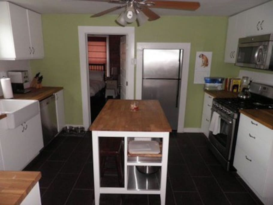 Spacious Kitchen with Range Top Stove stove and Farm Sink