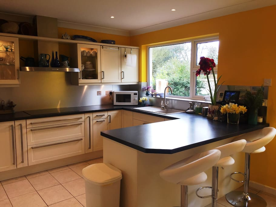 The bright, well-appointed kitchen has a hob, oven, microwave combi oven and a second microwave.  There is a Kuppersbusch dishwasher and fridge freezer, and a convenient breakfast bar. The kitchen opens directly onto a secluded patio.