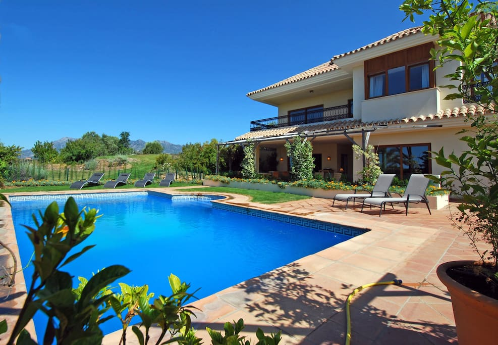 The villa and verandah from the pool, whence there is a view of Marbella's La Concha mountain range.