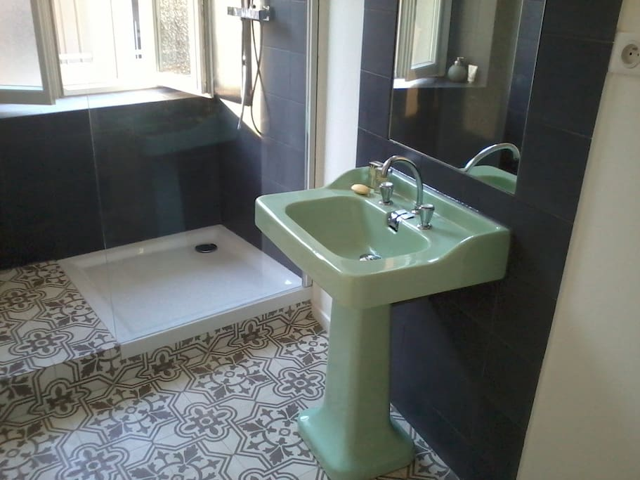 Bathroom and toilets, fitted with original vintage sink, traditionnal cement tiles and walk-in rain shower