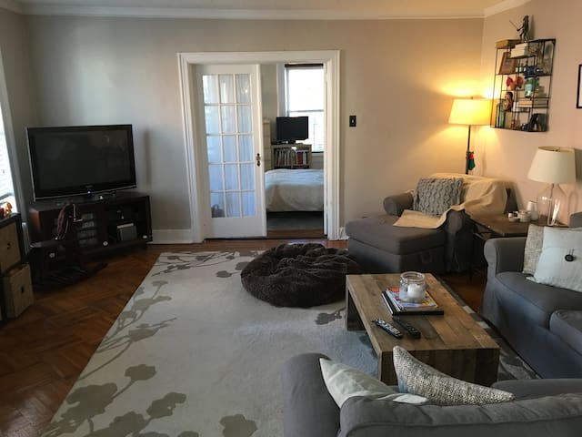 """Living room. Sectional couch seats 5, love seat with ottoman, 42"""" plasma TV"""