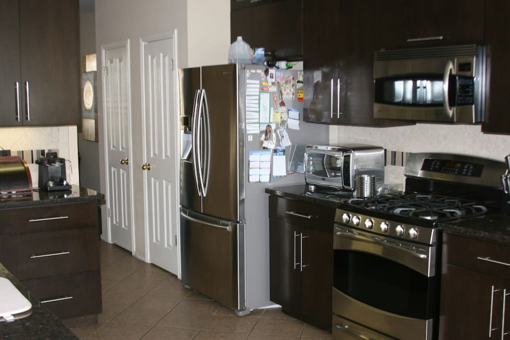 Large kitchen with espresso machine, Sodastream, much more