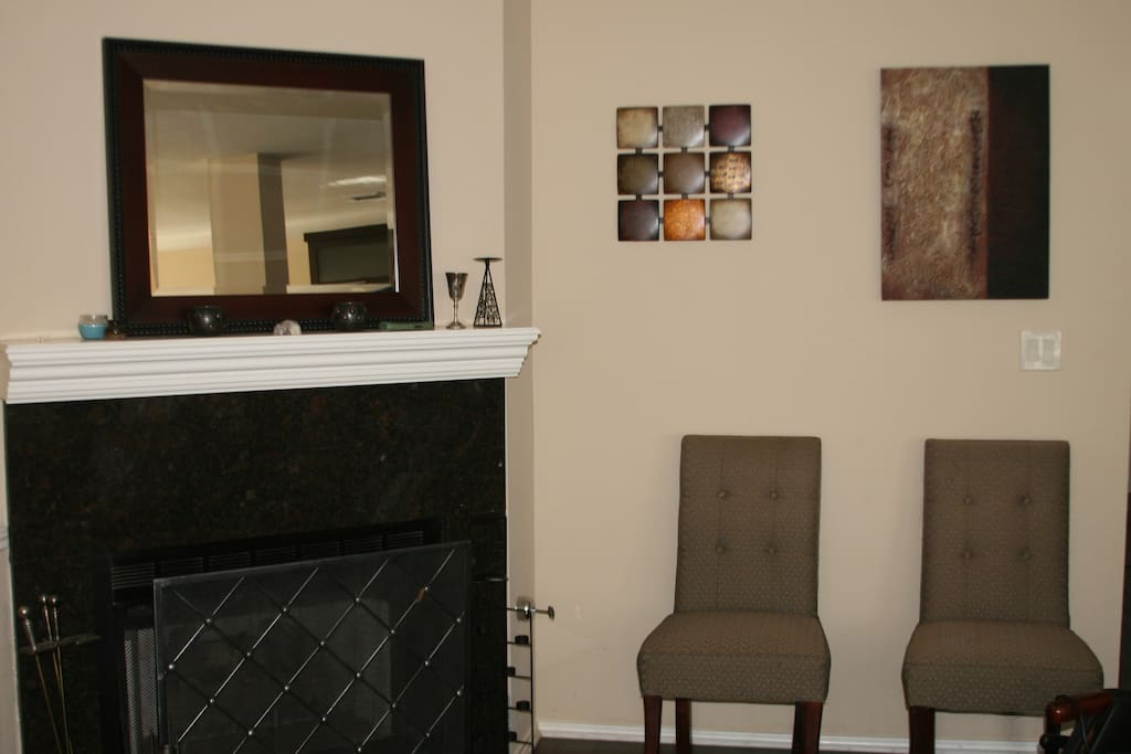 Shared living room downstairs with fireplace
