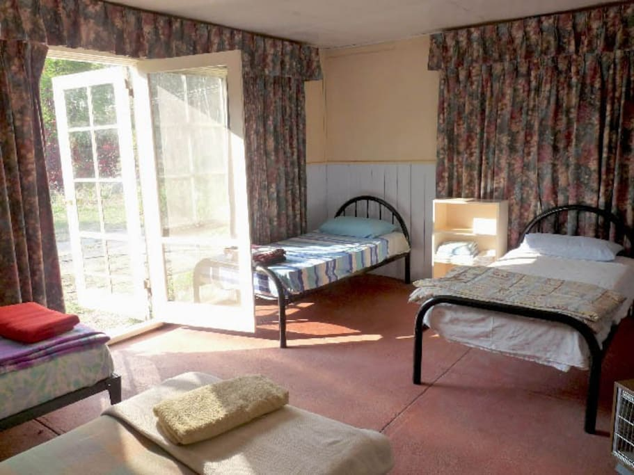 Front bedroom, 4.5m x 5.5m, 6 single beds, nice morning sun or block out drapes.