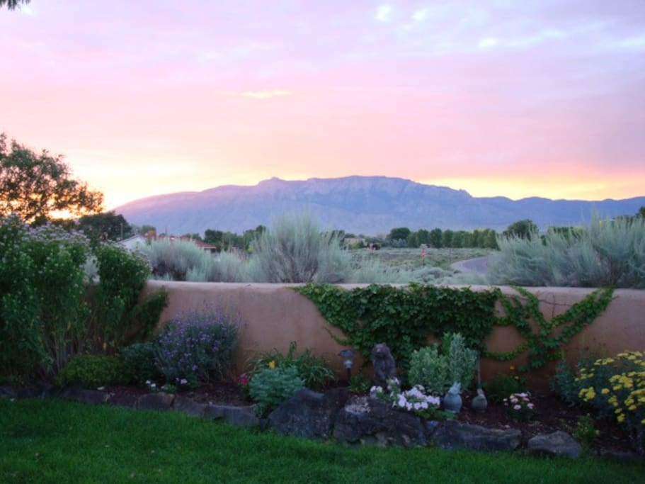 Nice lust lawn and garden with awesome moutain and sun set views
