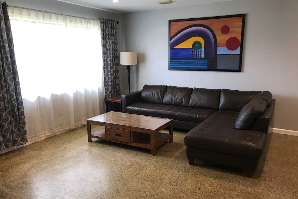 Comfortable living room with a leather sectional sofa