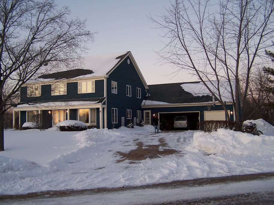 The house with attached garage/large driveway... the room is above the entire 3-car garage!