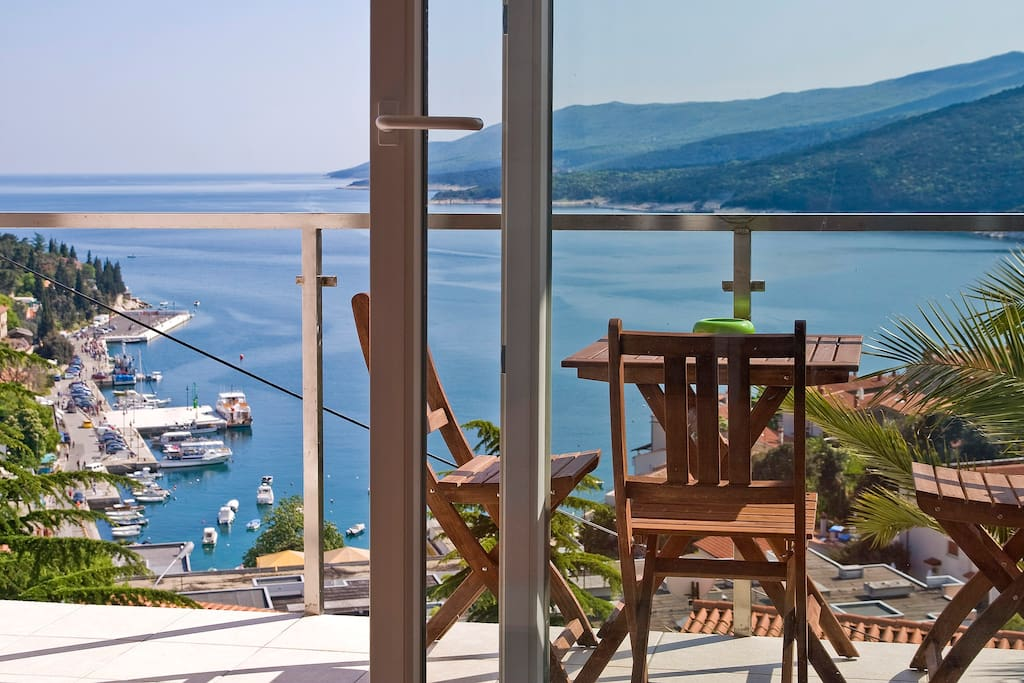 Balcony with panorama view on Rabac centre and Rabac bay