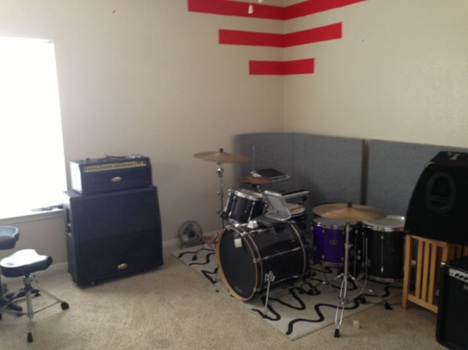 Large Room with rehearsal space and equipment.