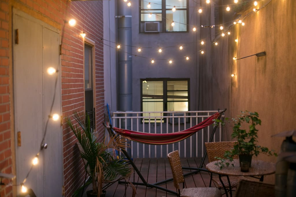 Perfect private patio for late night wine or reading or spending  time in the hammock.