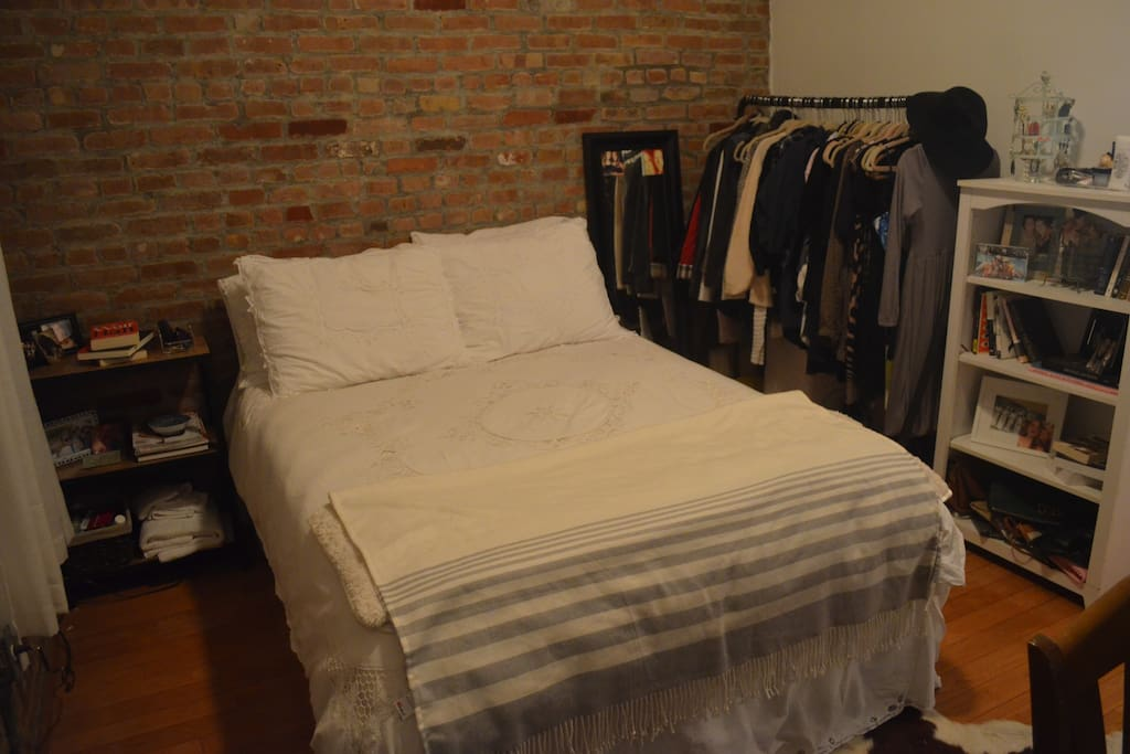 No closet, but you can hang items on clothing rack, if needed.