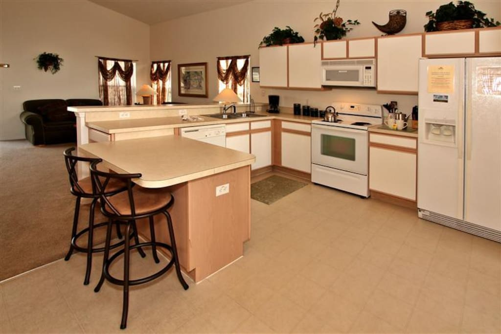 Large Kitchen with all of the appliances and bar stools