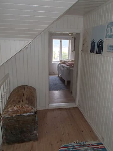 Corridor 2 end floor and bedroom with double bed.