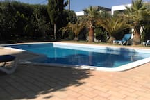 Walk in swimming pool, surrounded by mature trees, and a pool bar to chill out
