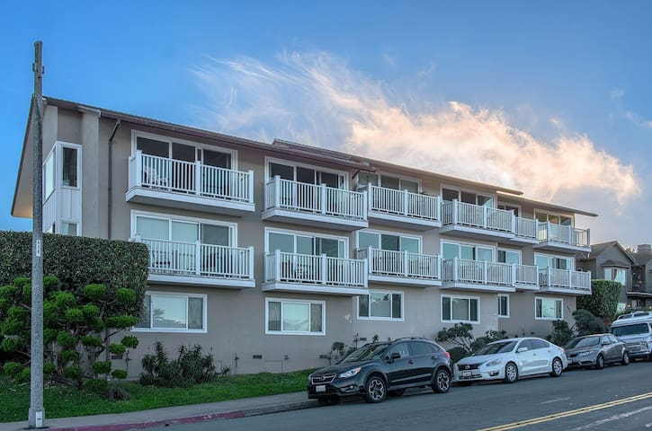 Bay-side photo of the condo building.